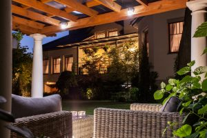 Picture of beautiful residence with garden at night photo by Vision Green Landscape